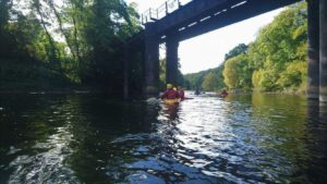 Kayaking under the bridge