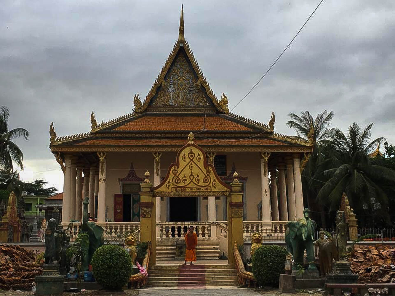 Monk and temple in Phnom Penh